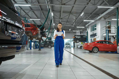 Female mechanic with laptop, car service