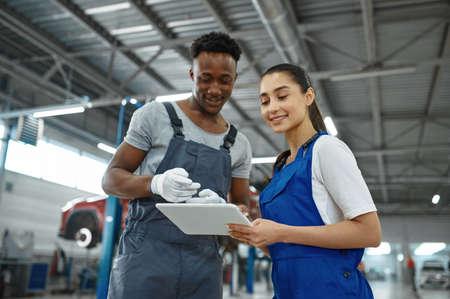 Male and female mechanics, car service
