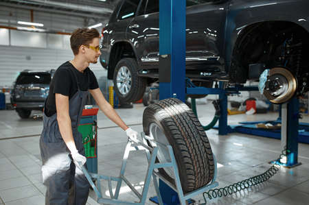 Mechanic fixes problem with wheel, car service