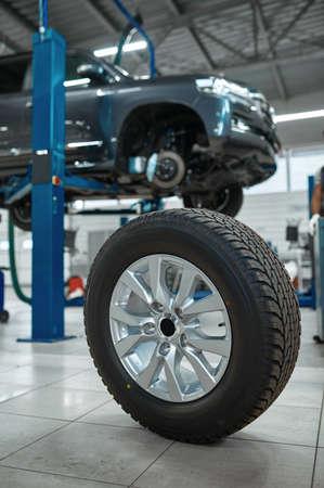 Car wheel, tire service concept, nobody Zdjęcie Seryjne