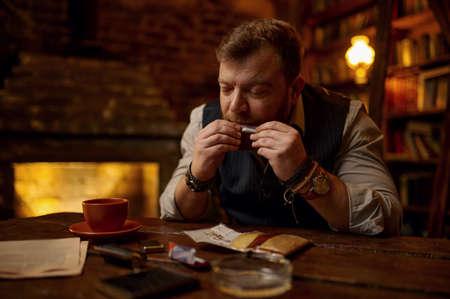 Man drooling a cigarette, tobacco smoking culture Imagens
