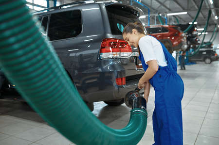 Male mechanic prepares for inspection, car service