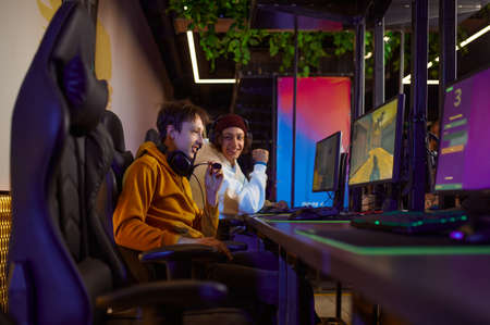 Two young gamers play in game club