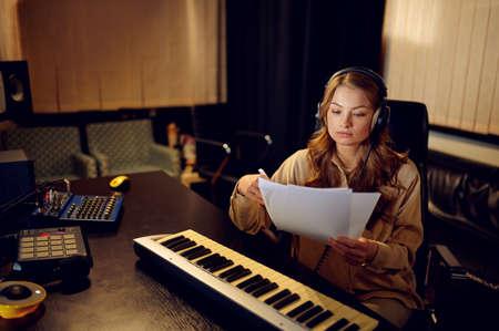Female engineer in headphones, recording studio Stock Photo
