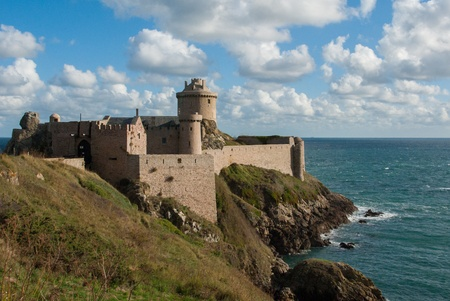 This castle is located in France, in Brittany, and is called Fort La Latte  Built in the XIV century, it s one of the most famous castle in Brittany