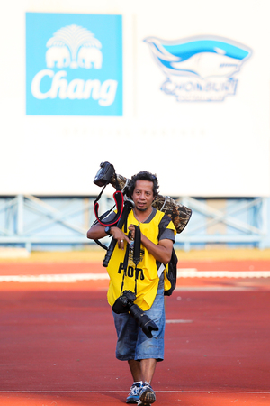 CHONBURI,THAILAND-J ANUARY 18 The portrait of Mr Jirawat Srikong who is the specialist sport photographer of Siam Sport news paper in acton at Chonburi stadium on Jan 18, 2014 in Chonburi,Thailand