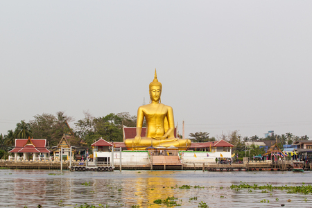 nonthaburi: NONTHABURI,THAILAND -FEBRUARY 1 The view of big golden buddha be side the Chao Phra Ya river at Ko-Kred on Feb 1, 2014 in Nonthaburi,Thailand   Editorial