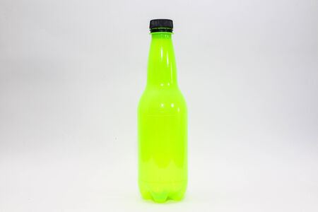 Yellow bottle isolated  photo