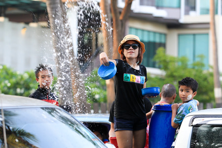 new year s day: CHONBURI,THAILAND-A PRIL 17 2014  Songkran Festival is celebration in a traditional New Year s Day from April 13 to 17,People enjoy with the splashing water together in Bangsan-Chonburi, Thailand