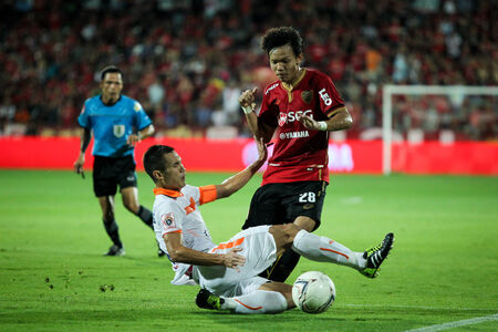 BANGKOK,THAILAND-MA Y 4 Unidentified Player of MTUTD in action during the TPL 2014 between SCG Muangthong United and Suphanburi FC at SCG Stadium on May 4, 2014 in Bangkok,Thailand