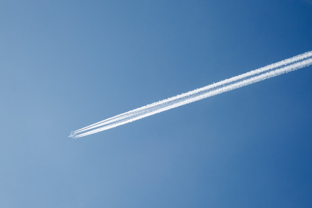 The jet plane is flying in clear sky  photo