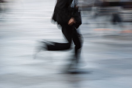 The motion blur of walking man in city  photo