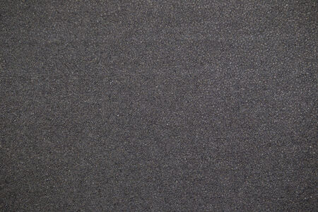 gray texture: Black rubber background. Stock Photo