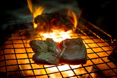 barbequing: Grilling steak.