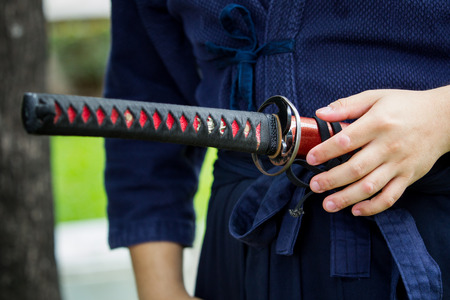 The treaditional Japanese sword Katana sword holding in Samurai hand prepare to flighting.