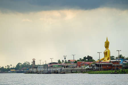 nonthaburi province: NONTHABURI,THAILAND-JULY 6: The landscape of traditional riverside city and the big buddha in Nonthaburi province taken on July 6,2015 in Thailand.