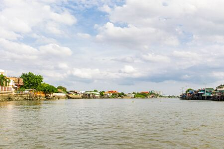 riverside landscape: The landscape of traditional riverside city in Nonthaburi province taken in Thailand.