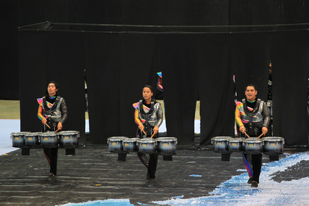 in unison: BANGKOK,THAILAND-AUGUST 21 : The photograph of Thailand International Drumline Contest 2015 at Chan Chai Acadium in August 23 2015.