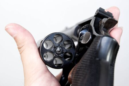 six shooter: The revolver hand gun holding on hand in white background.