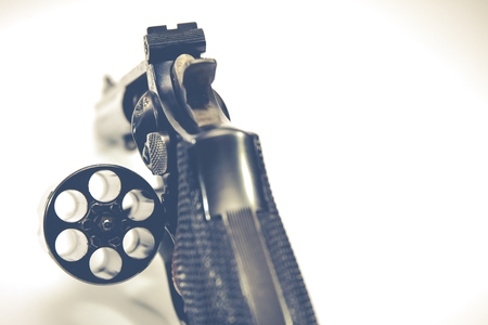 cal: Image of .38 Cal Revolver close up isolated.Vintage filtered Stock Photo