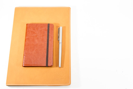 Classic leather notebook isolated in white background.