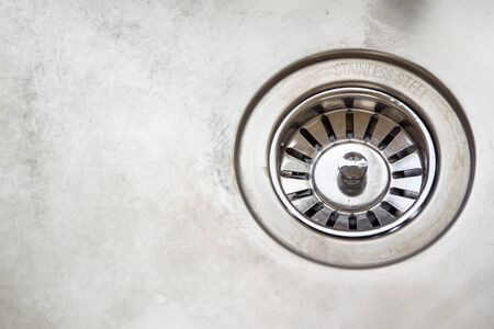 sink drain: Dirty stainless steel sink close up. Stock Photo