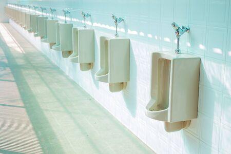 latrine: The image of public men toilet.
