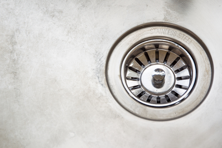 stainless steel sink: Dirty stainless steel sink close up. Stock Photo