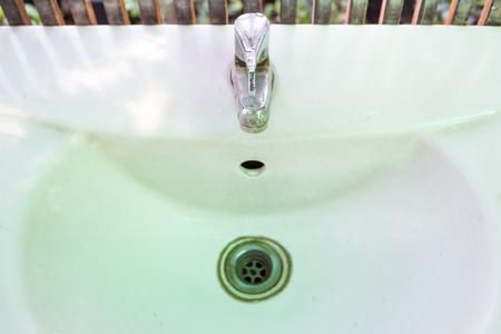 wash basin: Dirty wash basin close up. Stock Photo