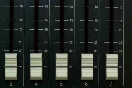 audio mixer: Audio mixer board close up on each channel controller.