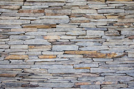 decorate: Stones art wall close up.