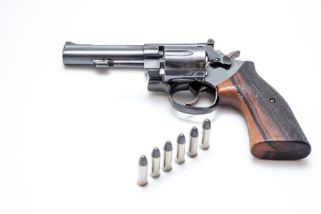 Revolver hand gun isolated on white background close up. Stock Photo