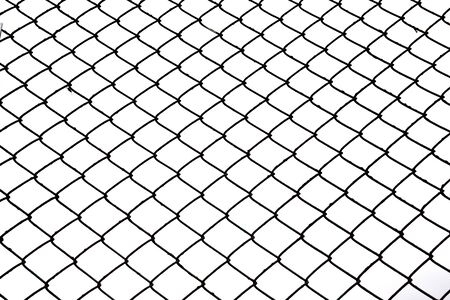 wired: Wired fence in shadow in background. Stock Photo