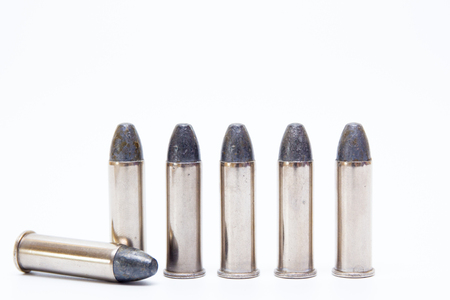 Silver Special  ammunition close up isolated on white background.