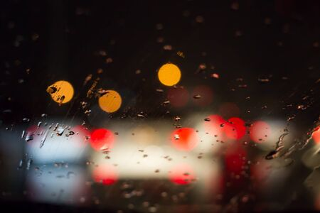 trafic: Blur image of rain drop on car glass while the trafic jam.
