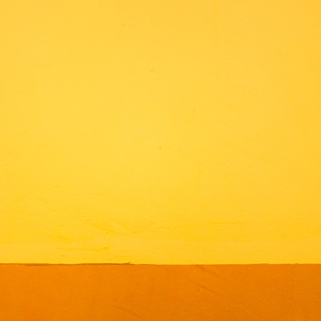 Aged Concrete Wall Painted In Orange And Yellow Colour. Stock Photo ...