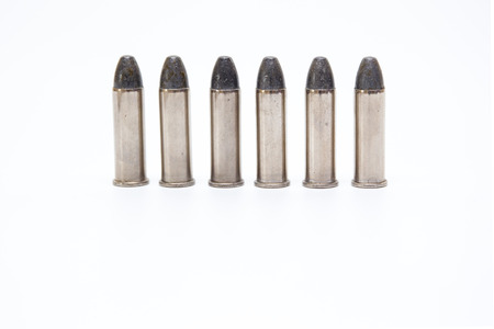 Silver .38 Special  ammunition close up isolated on white background.