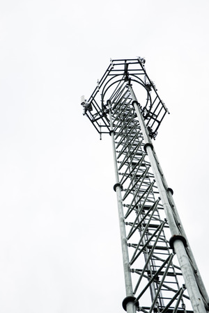 Telecom tower on white background close up. Stock Photo