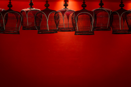 Bird cages in the red room.