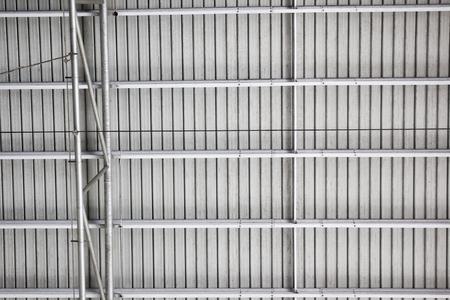 metalic: Photograph of the roof inside a big cargo.