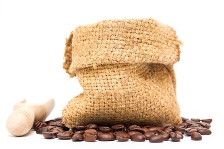 decaf: Organic coffee beans and wooden coffee dipper on white background close up isolated.