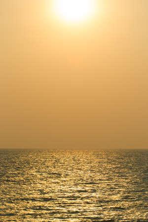 Landscape of the big sun over the sea close up.