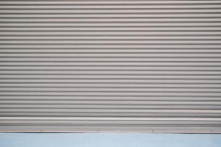 Rolling metal door of warehouse close up background.