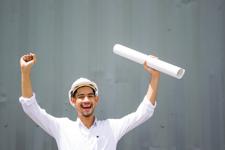Asian engineer age between 20-30 years old smiling when jobs done.