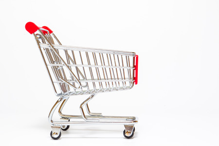 Basic style of shpping cart close up on white background.  Copy space on left side for text or other use.