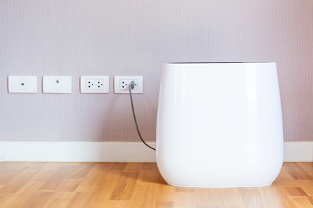 Modern portable air purifier in the room close up. Foto de archivo