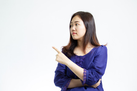 Portrait photograph of smart and good looking Asian women in the blue shirt close up on white background. Studio lighting set up.