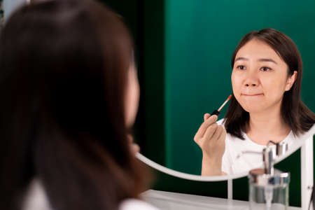 Woman and cosmetic concept.
