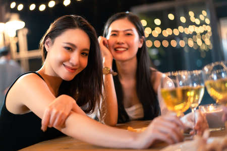Happy Asian women enjoy celebrating a new year eve festival together with a lot of drink and food. New Year Eve party concept.