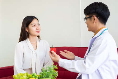 Asian young woman having a consultation with expert and professional nutritionist in hospital for planning about nutrition and eating program. Beautiful girl consult with doctor for food nutrition.